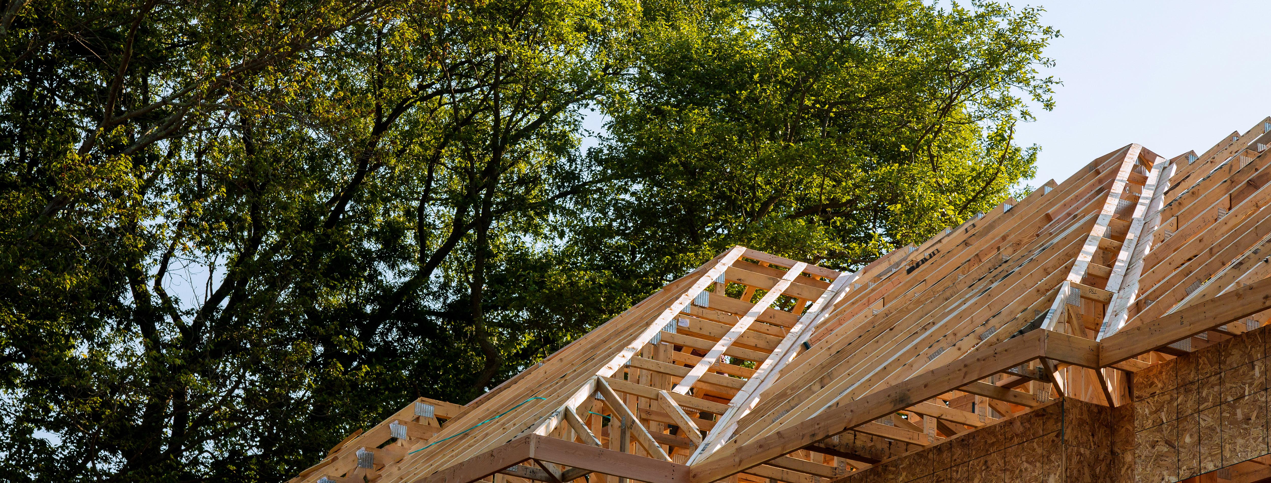 Framing beam of new house under construction home framing
